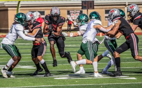 Senior wide receiver J. Micheal Sturdivant runs past Prosper players after catching the football.