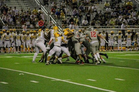 Players from Marcus and McKinney clash in the the third quarter of the game on Sept. 3.