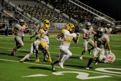 A McKinney player clutches the ball before getting tackled by Marcus Cade Venuk.