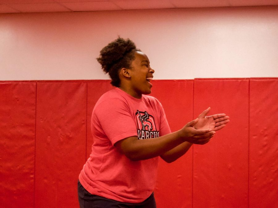 Coach Brittany Marshall claps enthusiastically for her wrestlers during practice.